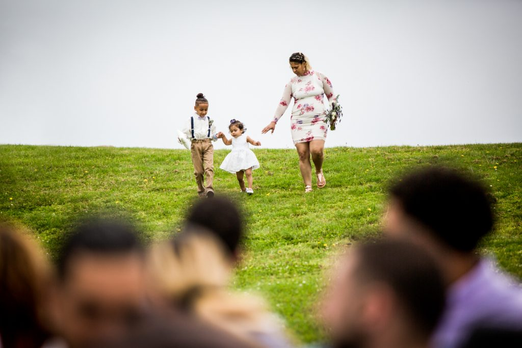 Flower girl walking down aisle for an article on Montauk Lighthouse wedding tips