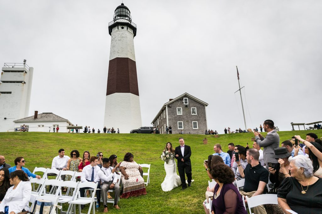 Bride walking down the aisle for an article on Montauk Lighthouse wedding tips