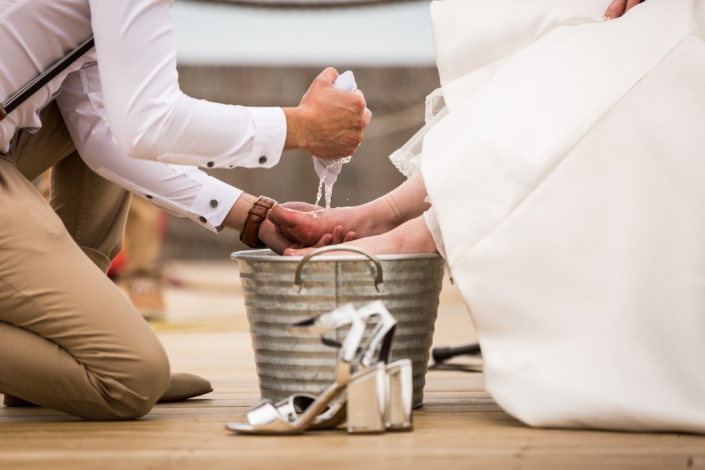 Feet washing ceremony for an article on Montauk Lighthouse wedding tips