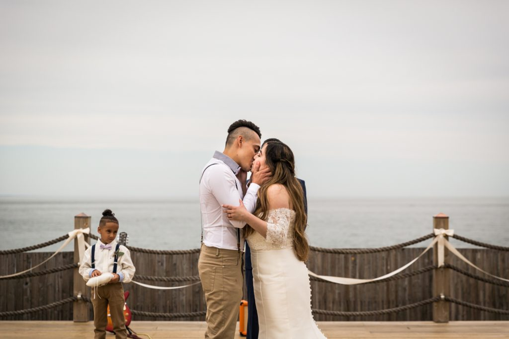 Bride and groom kissing for an article on Montauk Lighthouse wedding tips