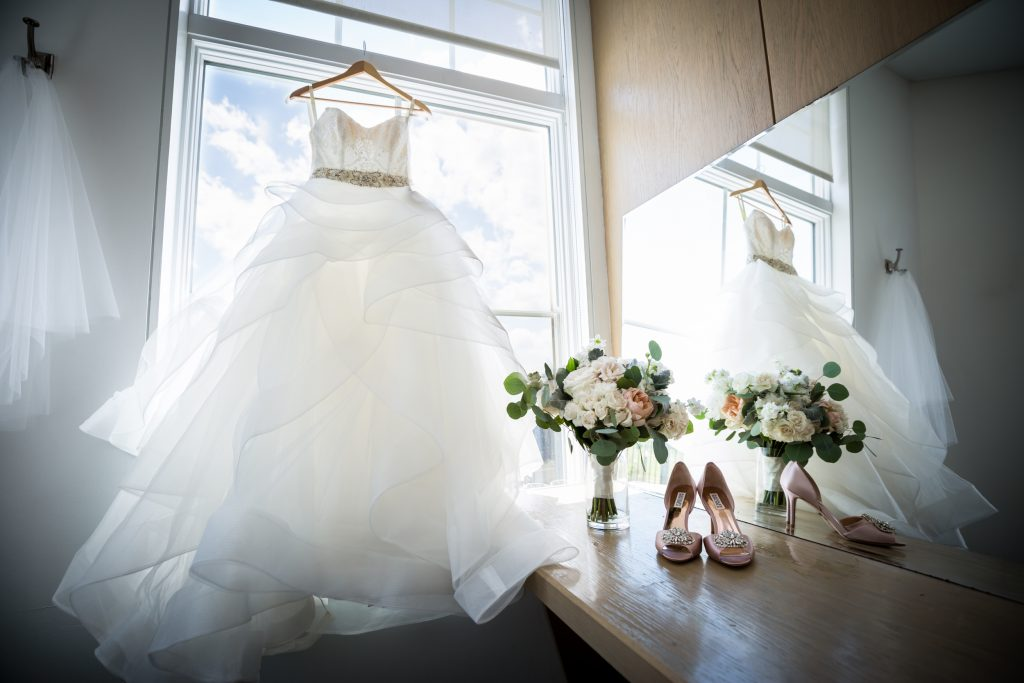 Wedding dress, bouquet, and shoes for an article on bouquet and garter toss alternatives