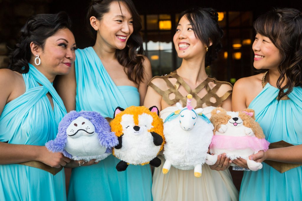 Bride and bridesmaids with stuffed animal bouquets for an article on bouquet and garter toss alternatives