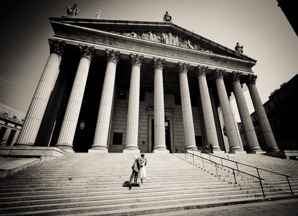 Couple on steps of NY Supreme Court for an article on City Hall wedding portrait locations