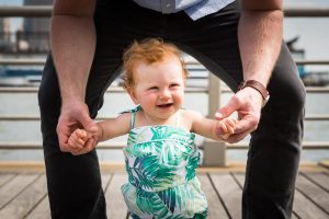 Smiling baby in a Hudson River Park Family Portrait
