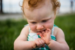 Baby chewing on fingers in a Hudson River Park Family Portrait