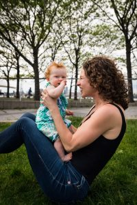 Smiling mother and baby in a Hudson River Park Family Portrait