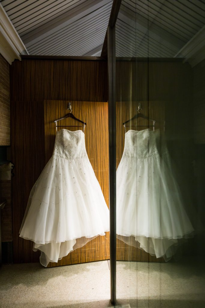 Wedding dress reflected in door at a Bronx Zoo wedding