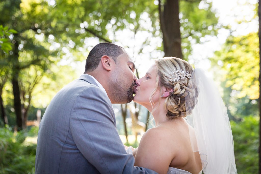 Bride and groom kissing at a Bronx Zoo wedding