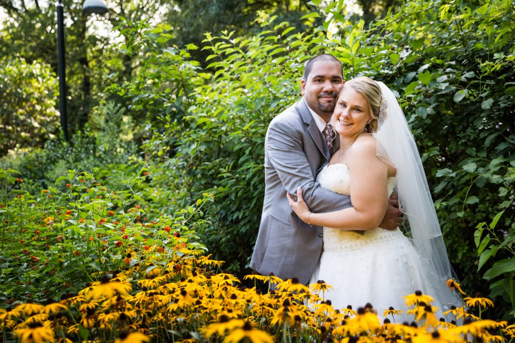 Bride and groom in butterfly garden at a Bronx Zoo wedding