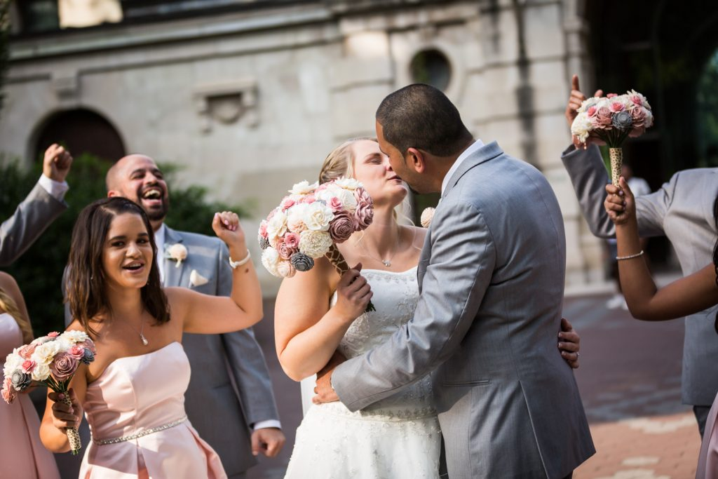 Bridal party cheering bride and groom at a Bronx Zoo wedding