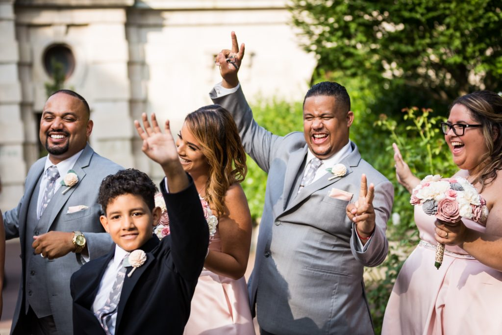 Bridal party cheering at a Bronx Zoo wedding