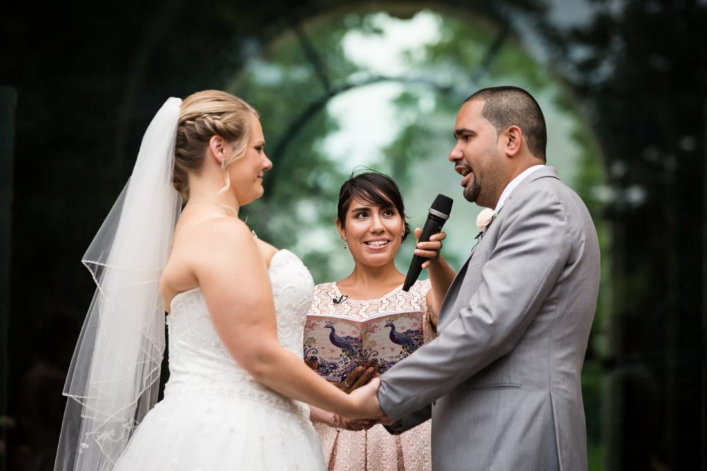 Groom saying vows to bride at a Bronx Zoo wedding