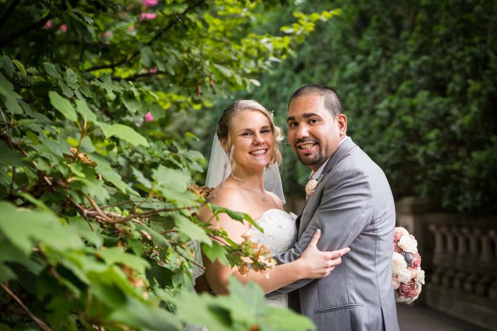 Bride and groom next to tree at a Bronx Zoo wedding