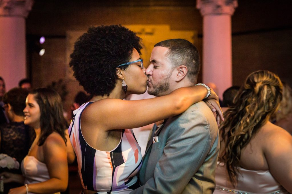 Guests kissing at a Bronx Zoo wedding