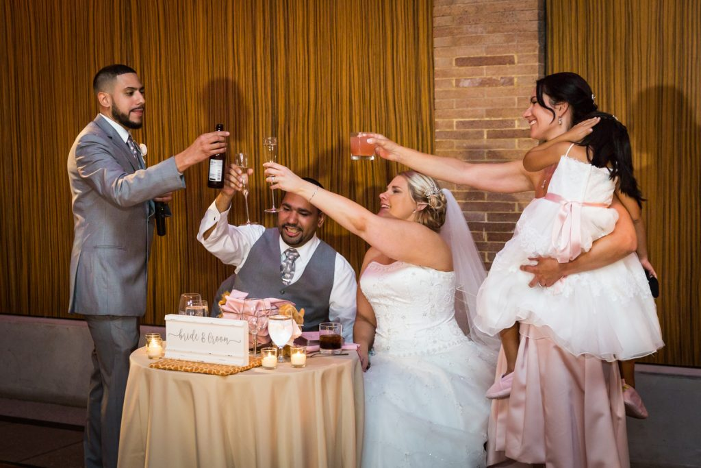 Bridal party toasting glasses at a Bronx Zoo wedding