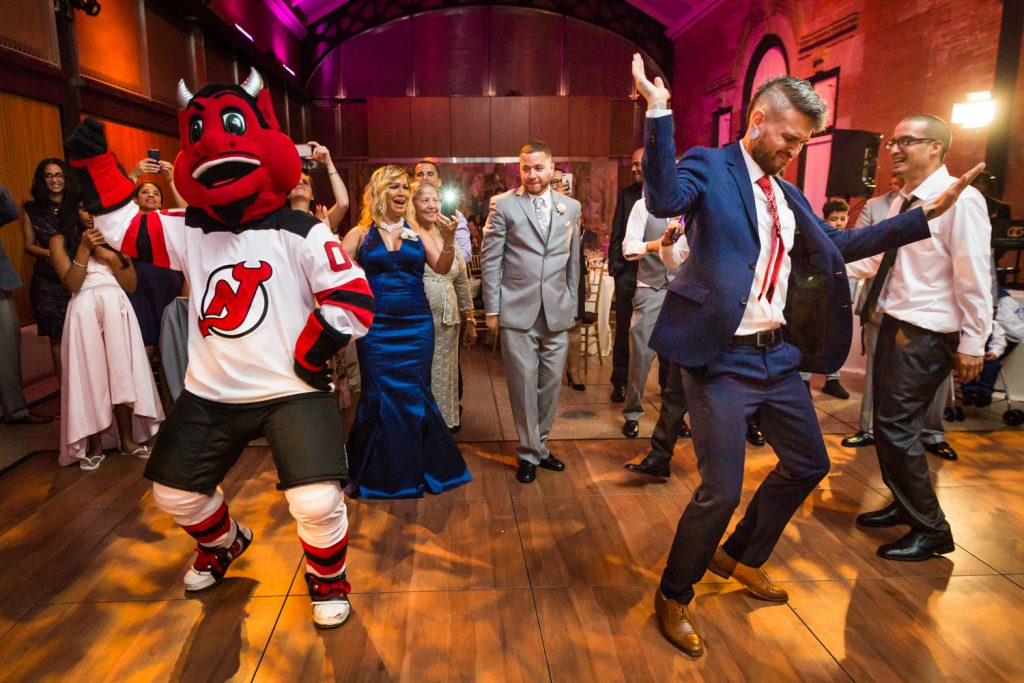NJ Devil mascot and guest dancing at a Bronx Zoo wedding