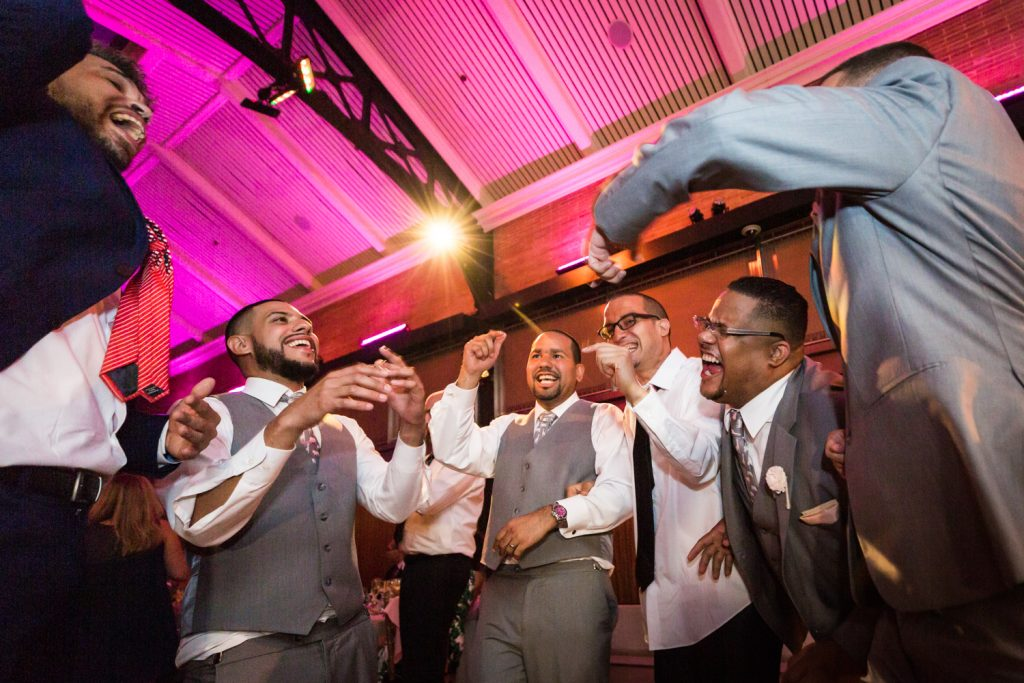 Groom and guests dancing at a Bronx Zoo wedding