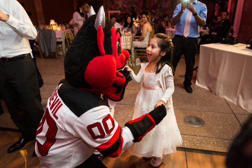 NJ Devil mascot dancing with little girl at a Bronx Zoo wedding