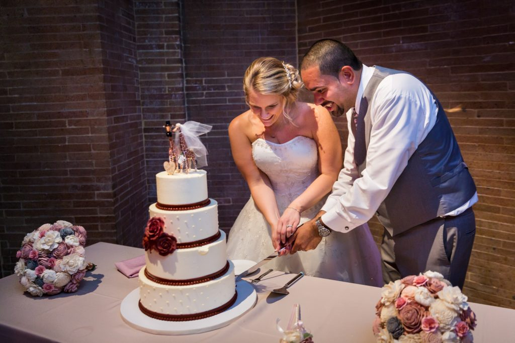 Cake cutting at a Bronx Zoo wedding