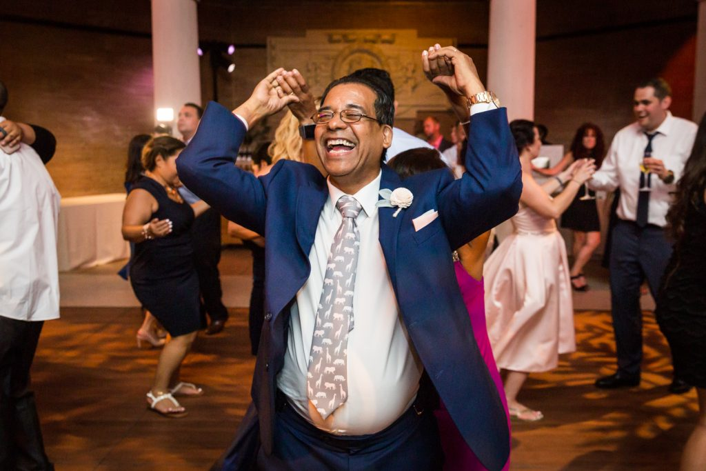 Father of the bride dancing at a Bronx Zoo wedding