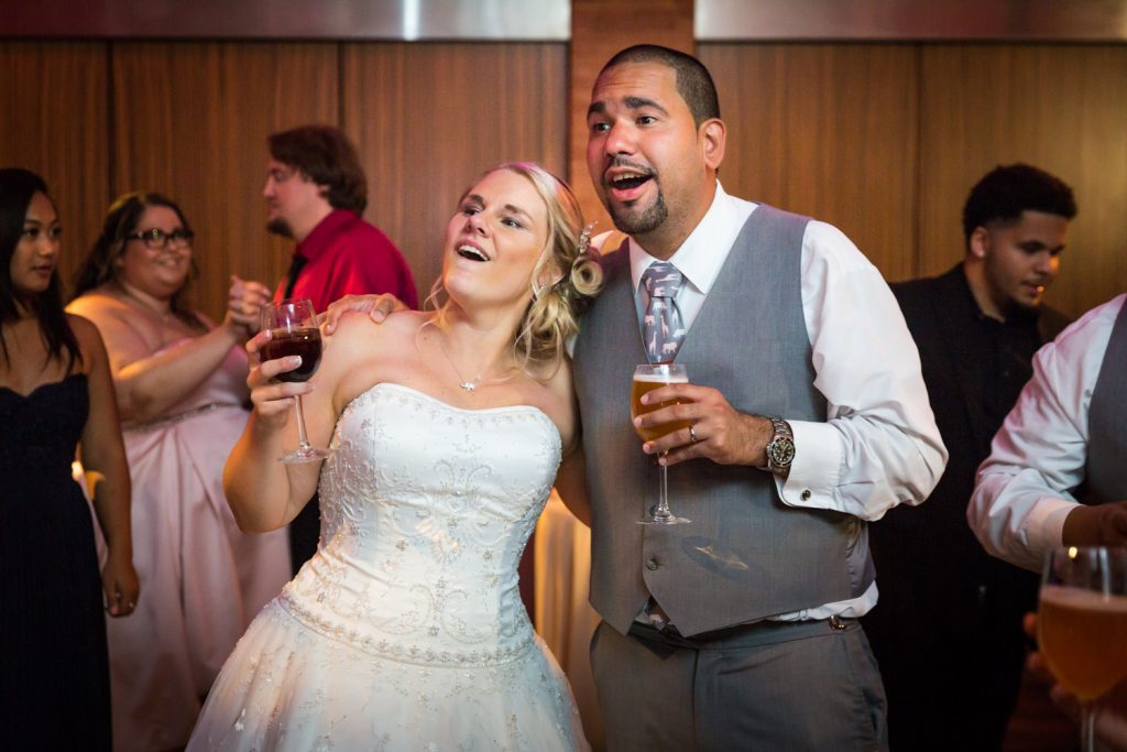 Bride and groom singing at a Bronx Zoo wedding