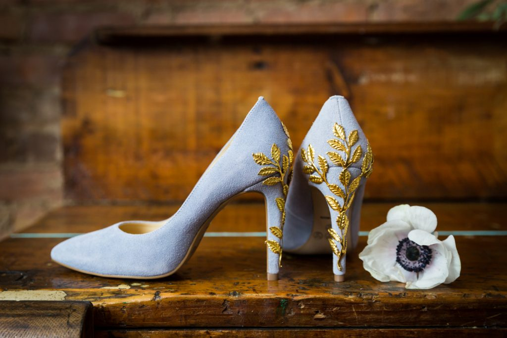 Purple suede heels with gold applique for an article on the pros and cons of a restaurant wedding