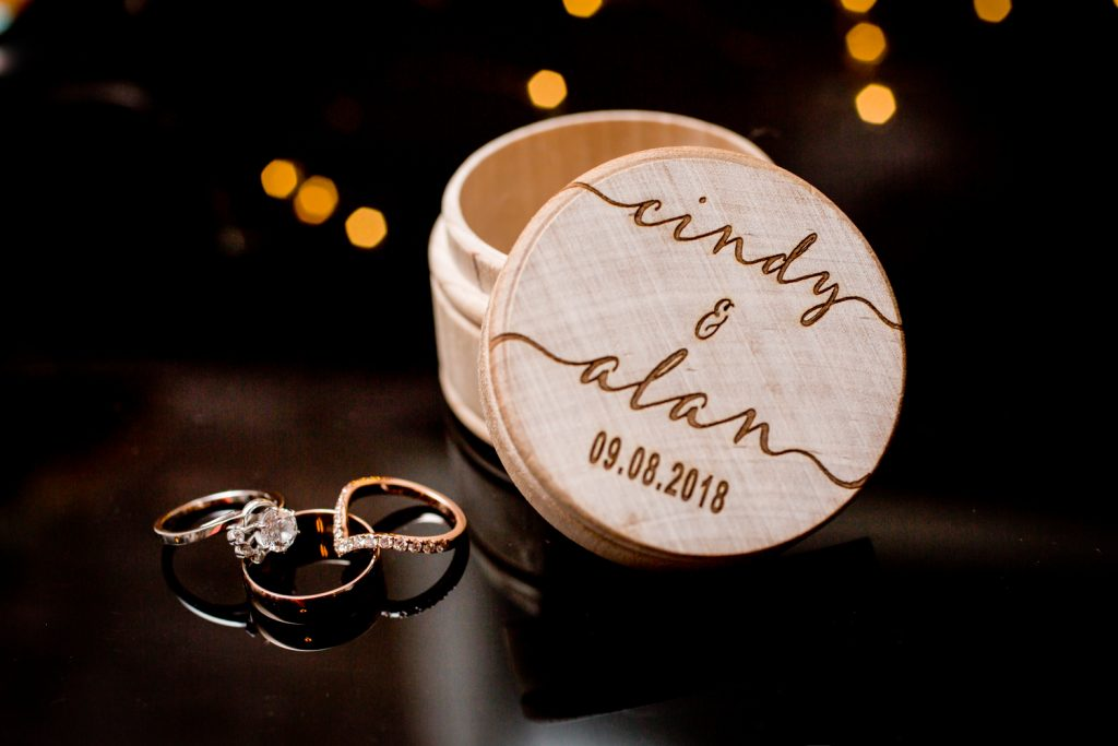 Wedding ring and wooden case for an article on the pros and cons of a restaurant wedding