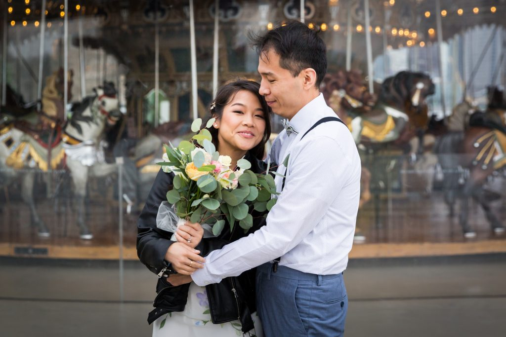 Portrait of groom hugging bride for an article on the pros and cons of a restaurant wedding