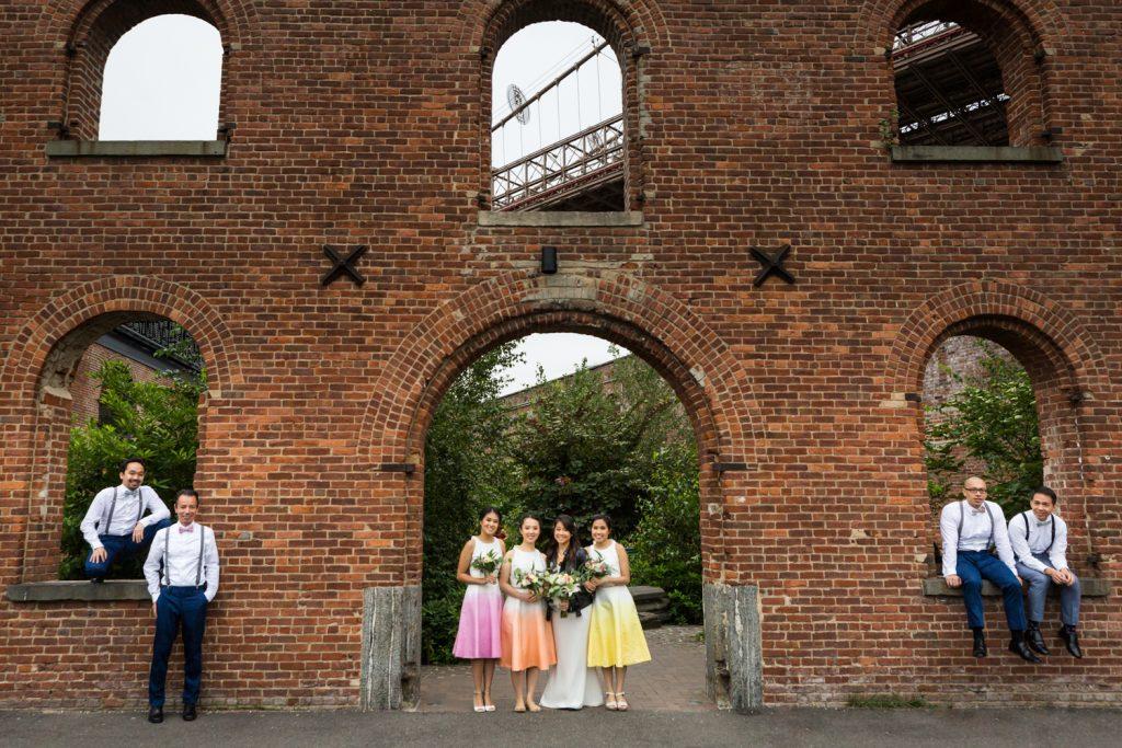 Portrait of bridal party in brick archways of Brooklyn Bridge Park