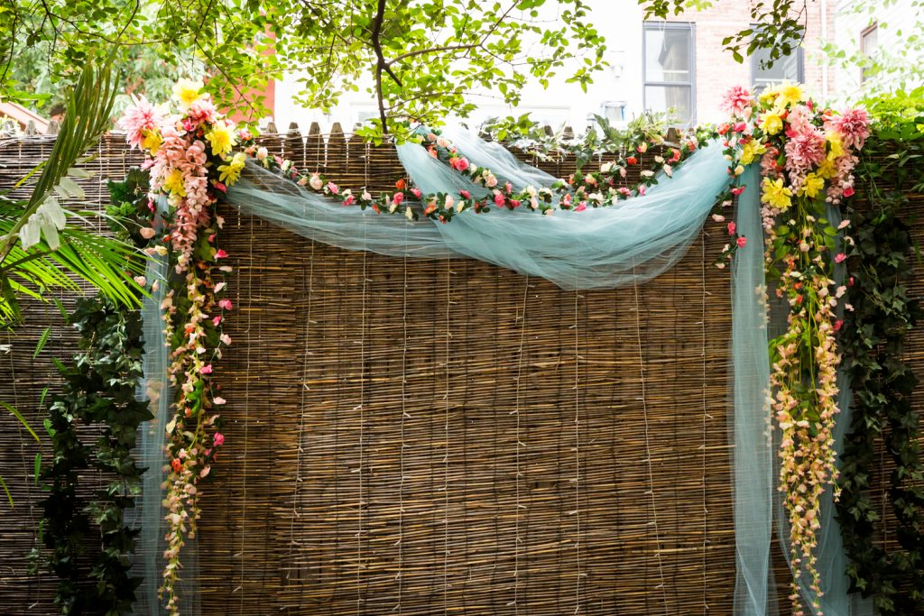 Floral arch for wedding ceremony for an article on the pros and cons of a restaurant wedding