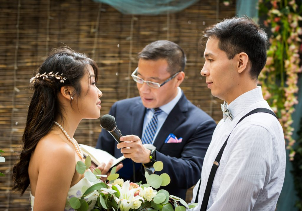 Bride and groom saying vows during restaurant wedding ceremony