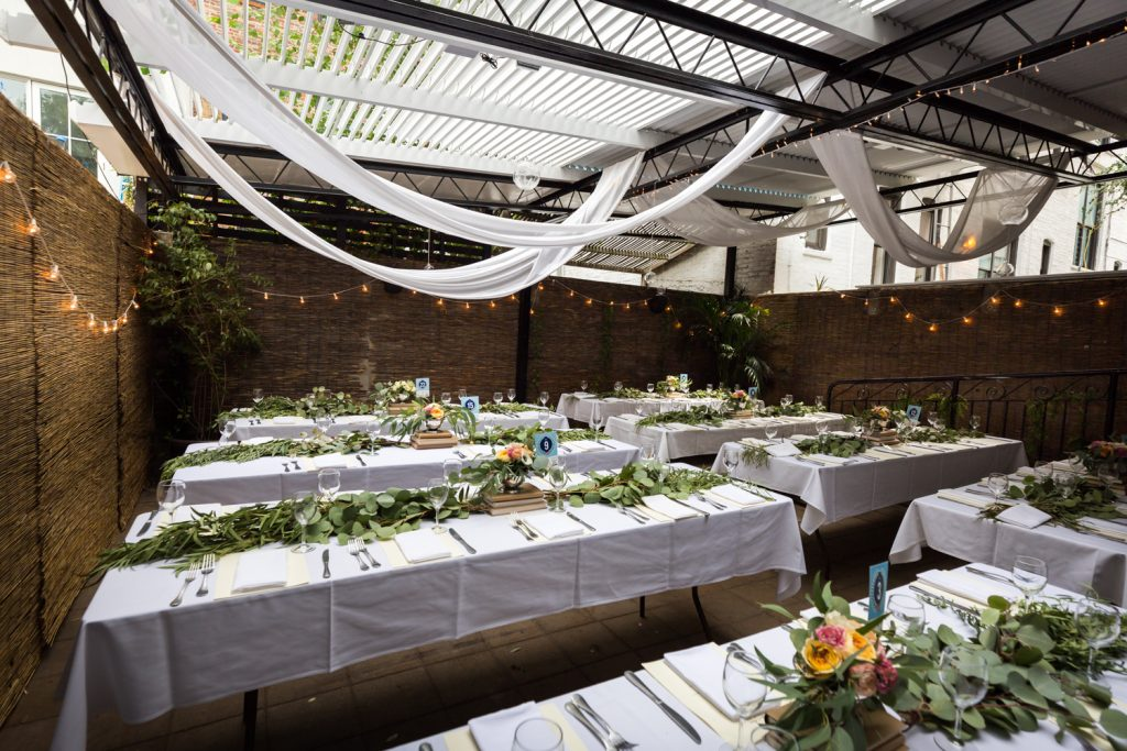 Set tables at restaurant wedding for an article on the pros and cons of a restaurant wedding