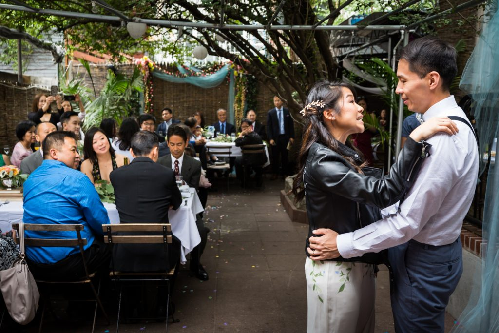 Bride and groom having first dance in restaurant patio