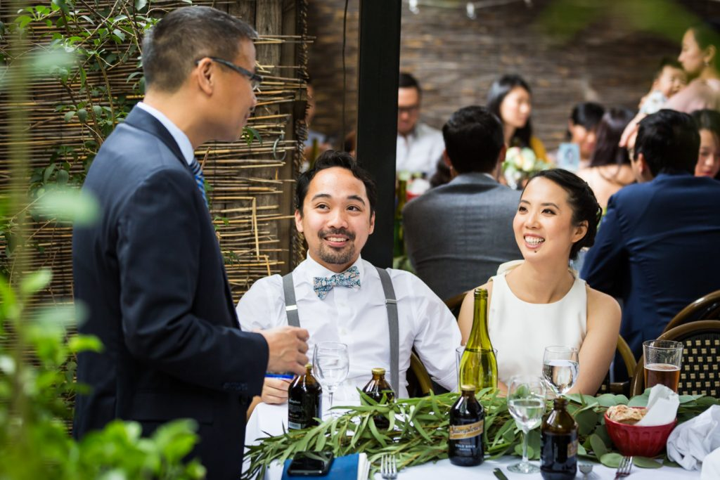Guests talking during reception for an article on the pros and cons of a restaurant wedding