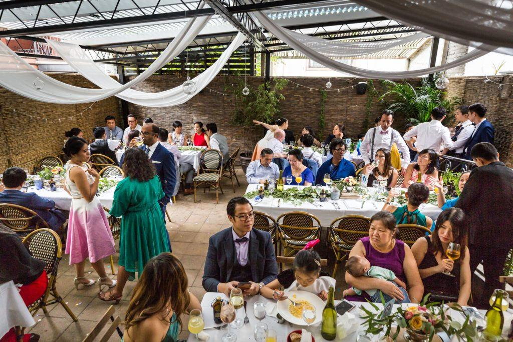 Guests in restaurant patio for an article on the pros and cons of a restaurant wedding