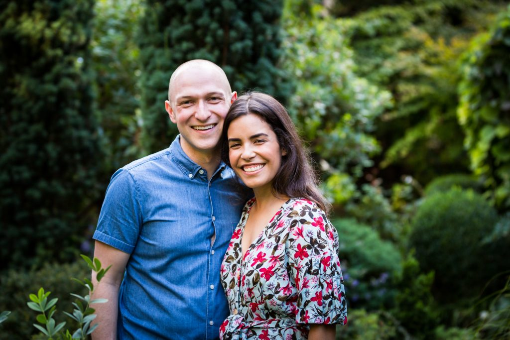 Couple in middle of garden at a community garden family portrait session