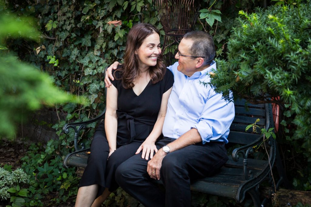 Older couple sitting in middle of garden at a community garden family portrait session