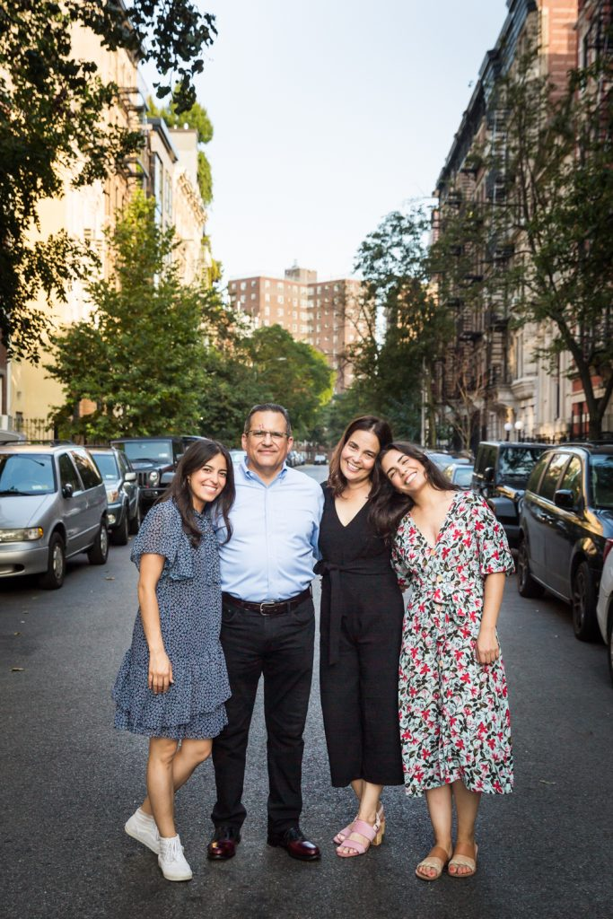 Family standing in middle of East Village street