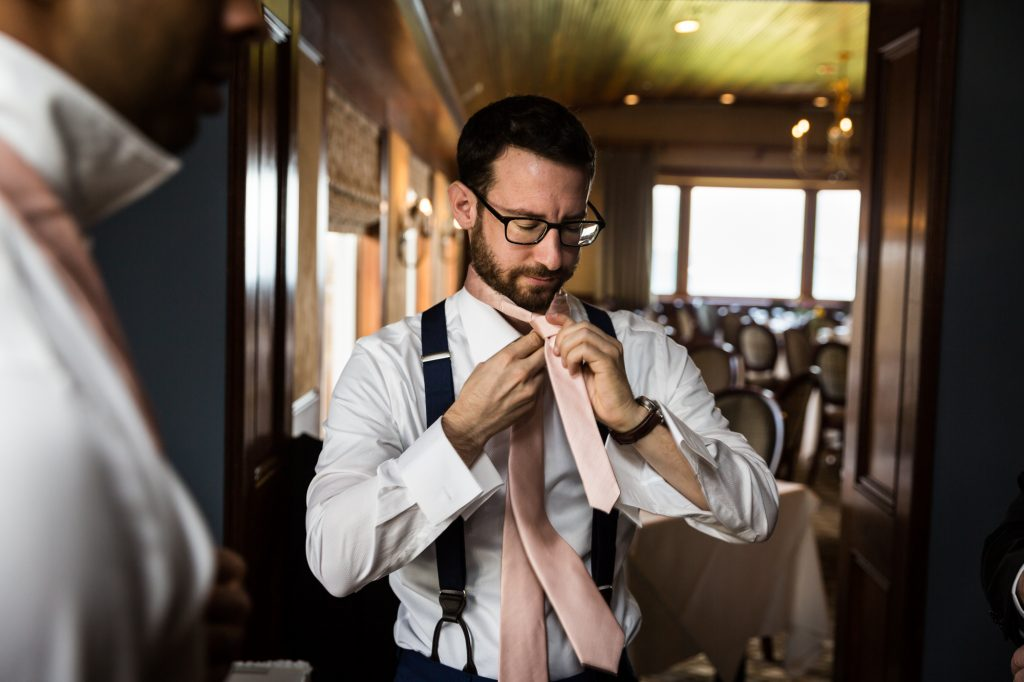 Groom getting ready at a Larchmont Shore Club wedding