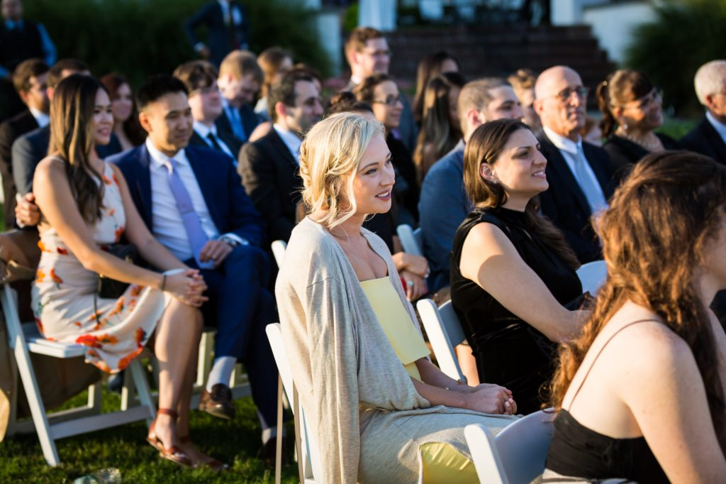 Guests at a wedding ceremony at a Larchmont Shore Club wedding