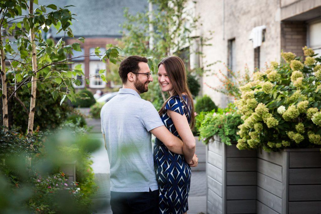 Couple posing for engagement portrait before ketubah signing