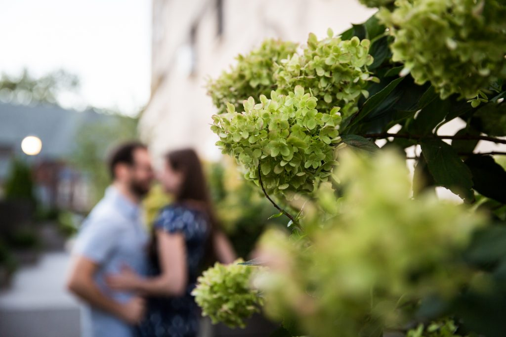 Couple posing in garden before their ketubah signing