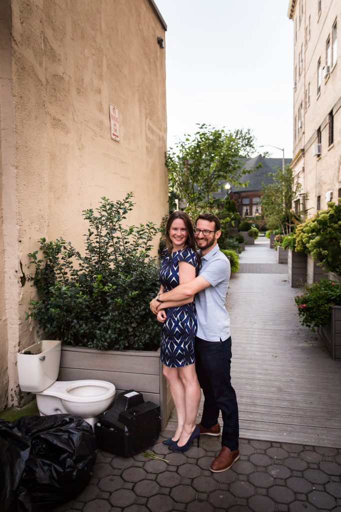 Couple posing in by toilet before their ketubah signing