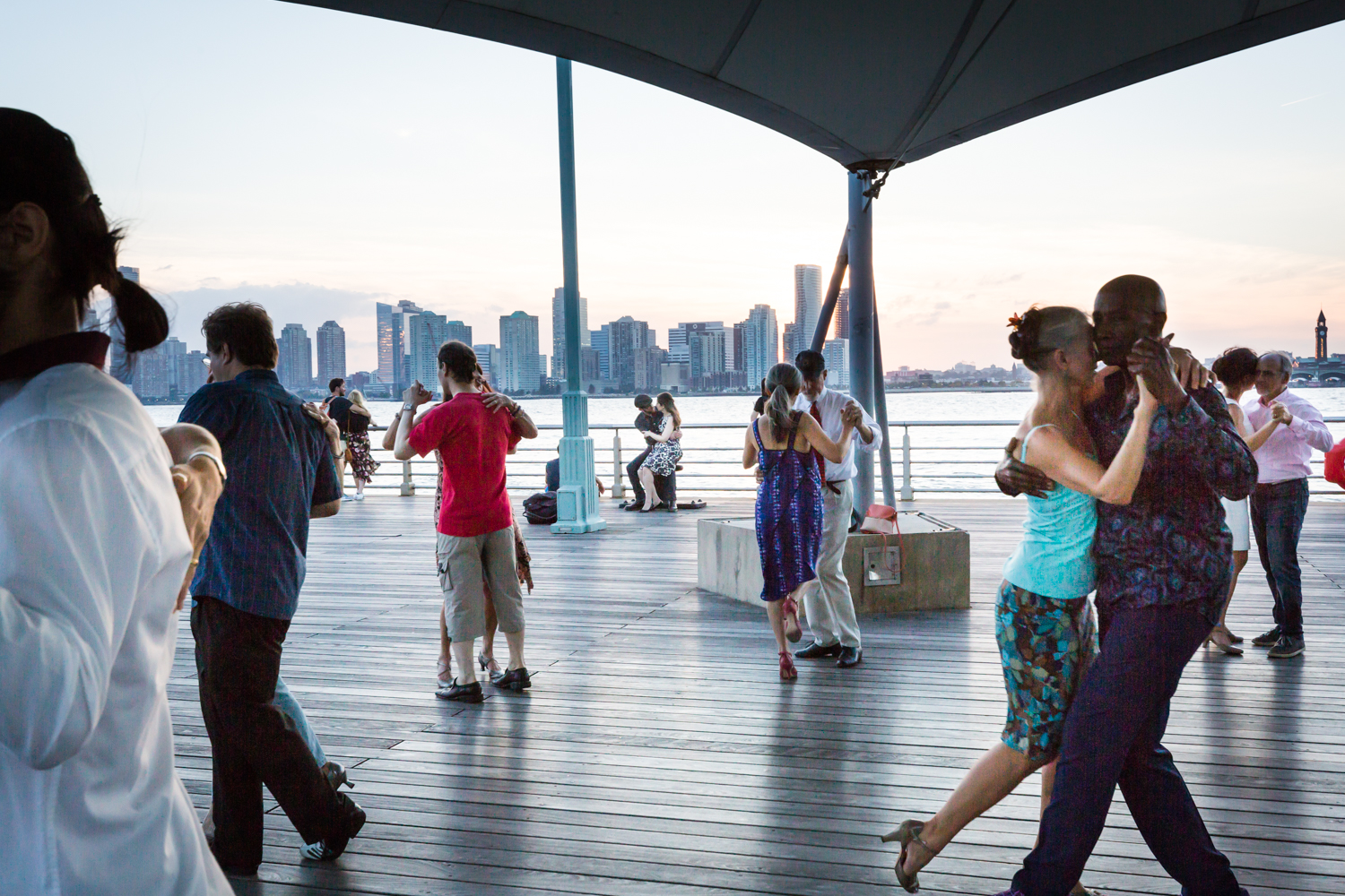 Couples dancing tango by the Hudson River for a Greenwich Village engagement portrait