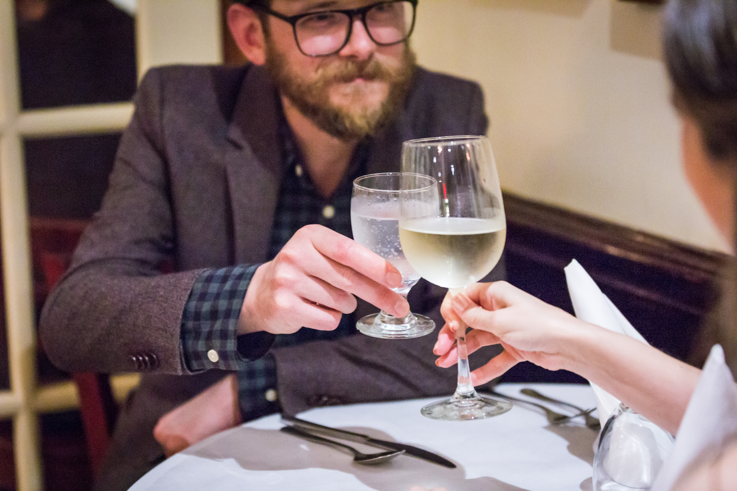 Couple toasting glasses in a restaurant