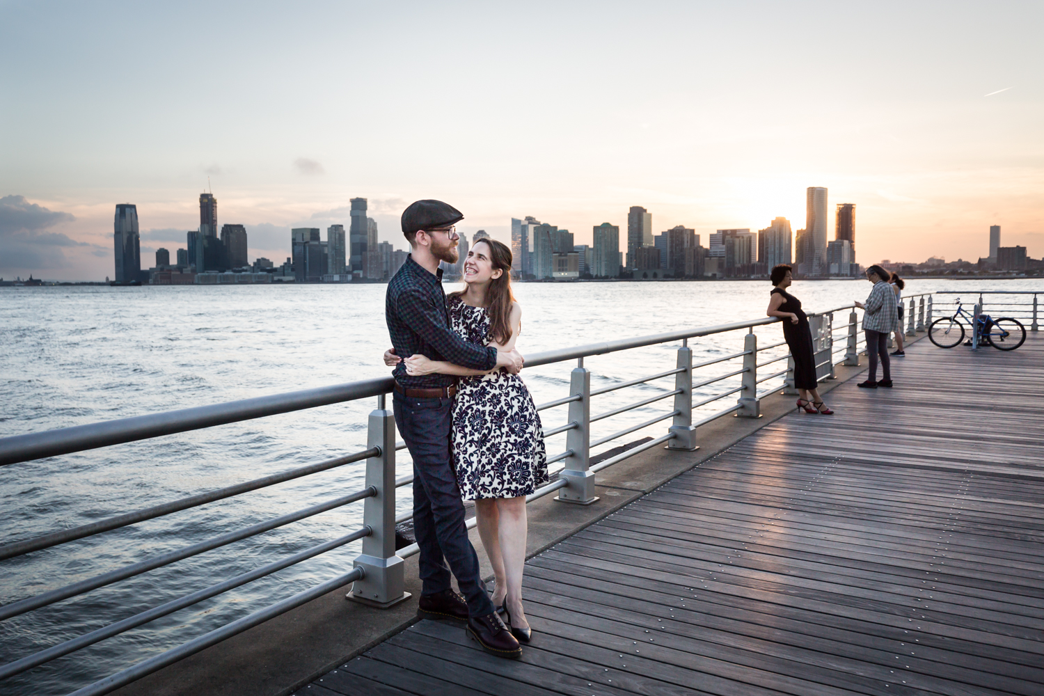 Couple leaning against railing in Hudson River waterfront park