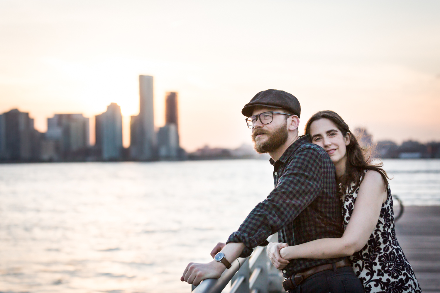 Woman hugging man from behind in front of Hudson River