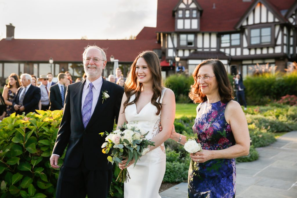 Bride and parents walking down aisle at a Larchmont Shore Club wedding