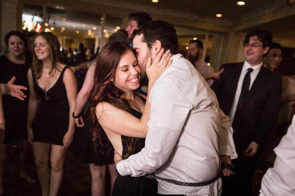 Couple dancing cheek-to-cheek at wedding reception