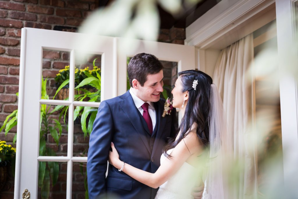 Bride and groom in corner of doorway
